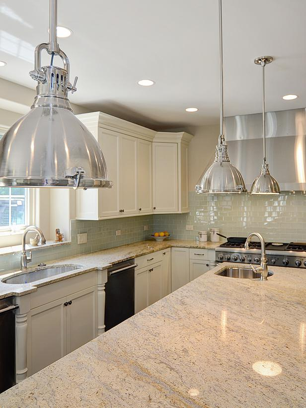 White kitchen with Bianco Romano Granite. The White Swan Bianco Romano Granite