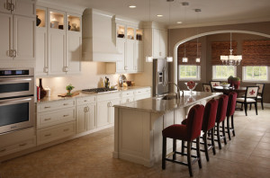 off white cabinets with delicatus brown granite