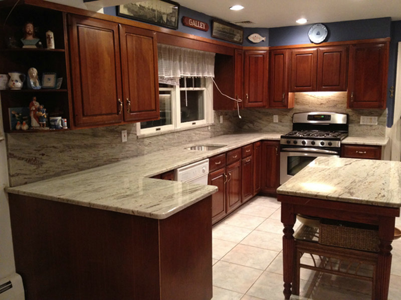 River white granite with dark cherry kitchen cabinet