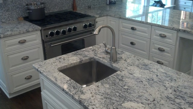 white ice granite , white kitchen cabinet