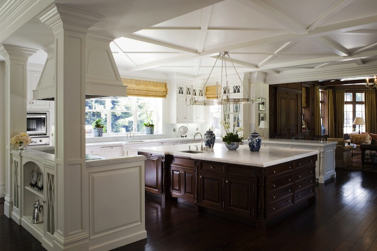 Oversized mocha kitchen island and honed carrara marble countertop.