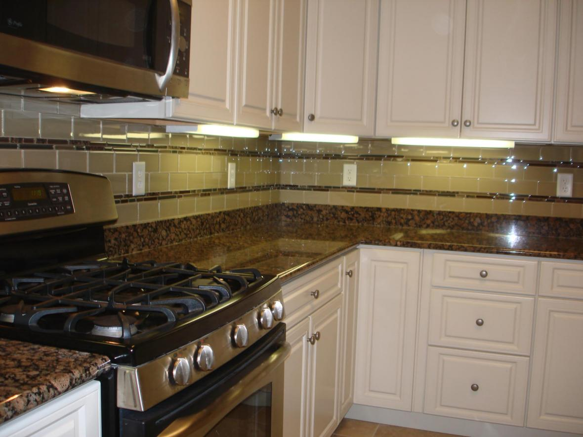 Baltic Brown Granite with white cabinets and custom glass granite and ceramic tile backsplash
