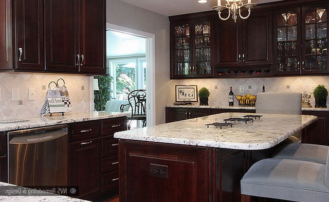 Colonial white with cappuccino  stain cherry  cabinets and diagonal travertine backsplash