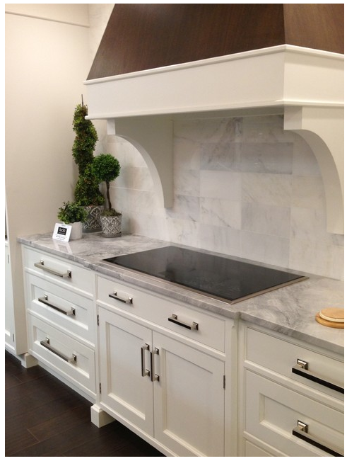 White carrara marble backsplash white fantasy granite with off white cabinets
