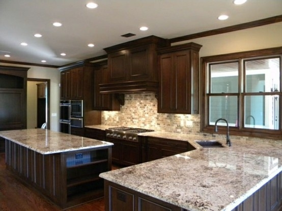 bordeaux stain cherry cabinets with colonial white granite and mosaic backsplash