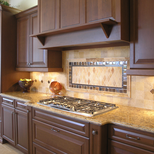 Santa cecilia granite with dark cabinets backsplash ideas for Backsplash ideas with black cabinets