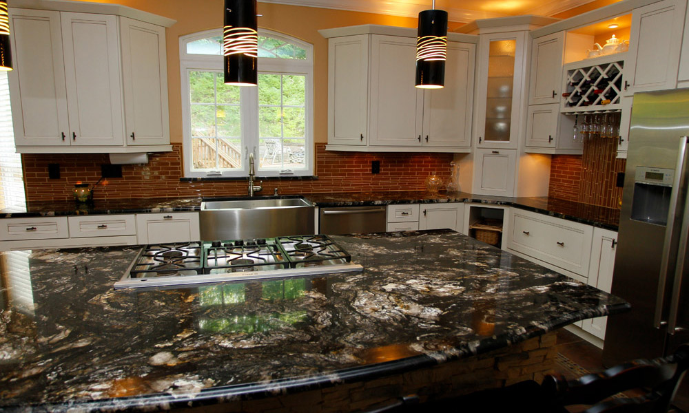 Titanium granite countertop with white cabinets