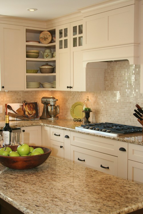 Backsplash color selection for white kitchen - Black granite countertops with cream cabinets ...