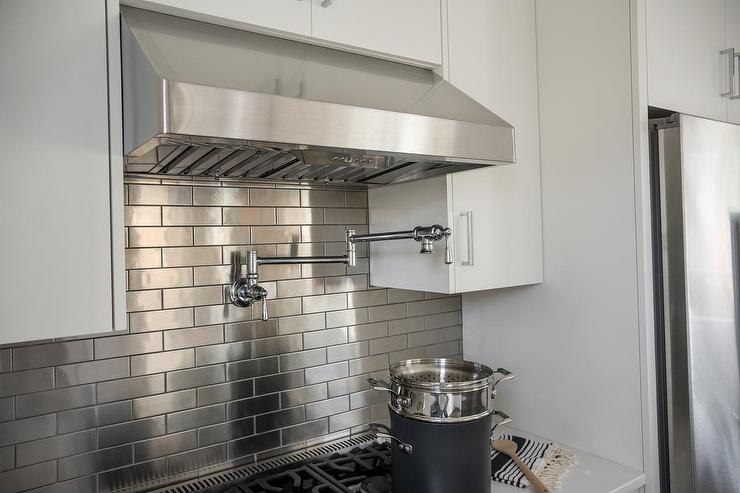 stainless steel brick backsplash